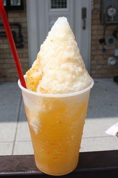 Mango/orange raspado with sweet condensed milk on top! YUMM