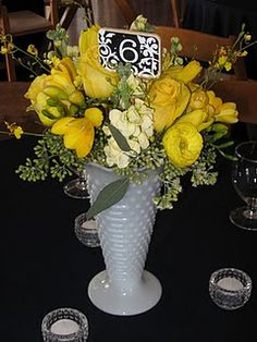 One of my favorite Milk glass Vases. I love the Yellow freesia. And look ... A table number too!