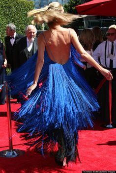 """Heidi Klum arrived at the Creative Arts Emmy Awards last night, August 16, in a dress made entirely of tiny strings by """"Project Runway"""" contestant Sean Kelly."""