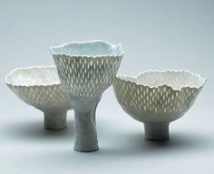 Porcelain vessels with translucent marks and tall feet. - Cornelia Trösch