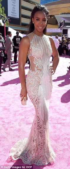 Flattering her figure: Kelly Rowland wowed in a beaded white gown and slicked back locks...