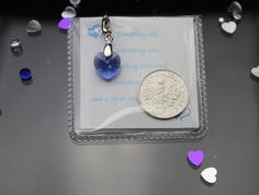 A Lucky Sixpence and A Something Blue Swarovski Heart Bride Garter/Bouquet Charm Sweet Treasure® http://www.amazon.co.uk/dp/B00CRDDMTY/ref=cm_sw_r_pi_dp_t46wub1QX5TXR