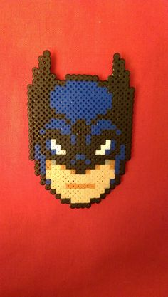 IM BATMAN! A Batman face sprite made from Hama Beads, this can be turned into a badge/magnet or Keyring at no extra cost, Just let us know