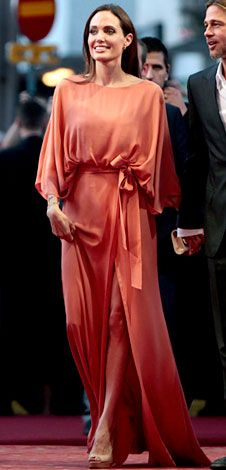 Angelina Jolie accepted an honorary award at the Sarajevo Film Festival in a coral Elie Saab gown and leather Jimmy Choo peep-toes.