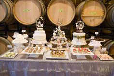 JM Cellars wine barrel room featured a bountiful array of delectable treats from Tallant House that were enhanced by hand-crafted from old millinery trims, vintage oddities, handmade fancies and German glass glitter, paper cake toppers and cupcake flags by Patricia Minish Designs.