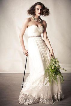 ivory ruched tulle strapless romantic informal floor length wedding dress