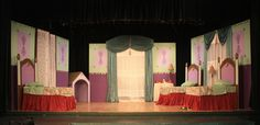 Google Image Result for http://www.jeannebenedict.com/wp-content/uploads/2011/04/Peter-Pan-Nursery-Pic-Wide.jpg      The most predominate colors are pink and green. Also, you see the use of rectangles throughout the set. The use of texture of the curtains and bed skirts also stands out.   I personally would have not used the red for the bed skirts because it draws the eye away from the entire set.