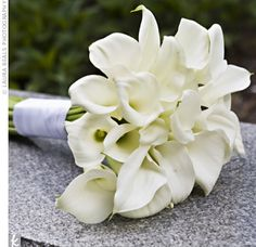 The bride carried an all-white calla lily bouquet wrapped with ribbon. To coordinate their looks, the groom wore a mini calla lily boutonniere Calla Lily Bridesmaid Bouquet, Calla Lillies Bouquet, Lily Bouquet Wedding, Wedding Flowers, Bridal Bouquets, Bridemaids Flowers, Bridesmaid Color, Prom Flowers, Boquet