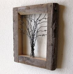 Reclaimed Barn Wood and Barbed Wire Tree Wall Art. This is about the ONLY thing barbed wire is good for. I could totally do this too. we have the wood and way too much crap barbed wire that I can't wait to make disappear. art design landspacing to plant