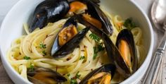 LINGUINE WITH MUSSELS RECIPE: Take a look at my recipe for making some delicious linguine with mussels. The sauce is made with sautéed onions and garlic, red pepper flakes, oregano, parsley, extra virgin olive oil, a dry white wine, vegetable broth, clam juice and a bit of butter. The cooked linguine is then added into the sauce and tossed until combined