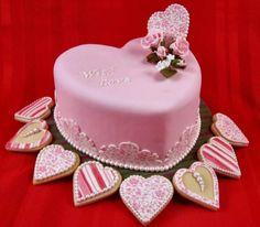 Fondant and cookies make this pretty Valentine cake