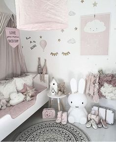 Dusky pink nursery with a minimalist vibe, cloud cushions and scandi decor Credit: @mykindoflike ✨