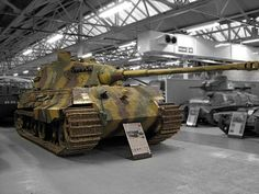 "German heavy Tiger II tank preserved at Bovington Tank Museum, UK.  The final official German designation for the Tiger II was Panzerkampfwagen Tiger Ausf. B, often shortened to Tiger B. The ordnance inventory designation was Sd.Kfz. 182. It is also known under the informal name Königstiger (the German name for the ""Bengal tiger""), often mistranslated as King Tiger or Royal Tiger by Allied soldiers."