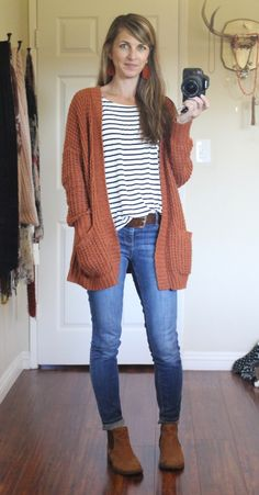 Jeans, black and white stripes, and rust cardigan.