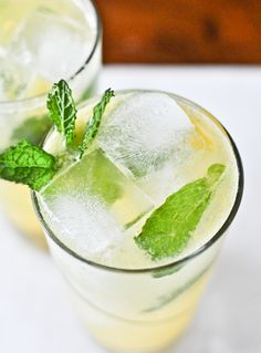 Coconut Mango Mojitos: 6-8 fresh mint leaves, 2 1/2 ounces of mint simple syrup, 1 oz. of coconut rum, 1 1/2 ounces of club soda, 1-2 ounces of mango puree, the juice of one lime. Directions: combine 1 peeled + chopped, ripe mango in a food processor with the juice of 1 lime, and process until smooth. In the bottom of a glass, add 1 oz. of simple syrup and the mint leaves. Muddle. Add ice to the glass, and pour rum, syrup, mango puree, lime juice and club soda over top. Mix and serve.