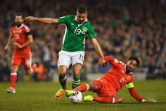 Ashley Williams of Wales challenges Jonathan Walters of the Republic of Ireland during the FIFA 2018 World Cup Qualifier between Republic of Ireland and Wales at Aviva Stadium on March 24, 2017 in Dublin, Ireland.