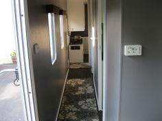 Camper Remodel 2, New paint and hallway runner., Other Spaces Design