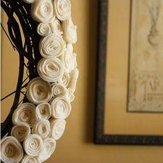 felt.  rose.  wreath.  The tutorial is here:  http://theprettypoppy1.blogspot.com/2010/07/pretty-little-rosie-wreath.html