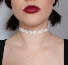 "More flower chokers. I would love to have one of these. Not as ""typical emo"" as regular black ones."