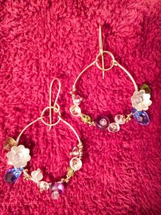 Earrings fashioned with 14k GF wire, Sterling, Swarovski crystal, amethyst, peridot, and Quartz, with 24k gold-plated 15• seed beads. Hand-crafted ear wires. bohobeads@yahoo.com