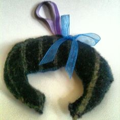 Hairstyle #felted hanging decoration, made from a sweater, shrunk in the washing machine. Organza ribbon bow on one side & button on the other.