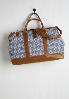 Revivals and Departures Weekend Bag in Blue and White. Though youre a fan of modern transit, you adore the vintage-inspired vibes of this woven weekend bag, making it your getaway go-to. #multi #modcloth