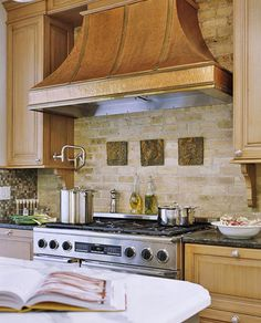 copper range hood and gorgeous backsplash