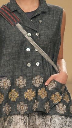 Cut out flowers or symbols from other fabrics and appliqué onto plain shirts