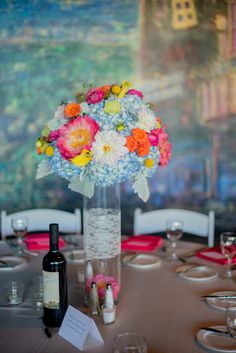 Beautiful bright spring color decor at wedding reception in the Chateau Elan Winery. Jenny + Andrew Wedding Reception Atlanta, Georgia wedding venue | indoor, outdoor, catered, spa, hotel, winery, vineyards, golf | www.chateauelan.com/weddings #angelwingsphotography