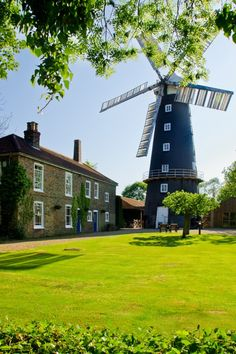 'Alford windmill and tearooms, Lincolnshire' by Mick Carver. Alford windmill is one of the few five-sailed windmills left in the UK. It is a working mill and produces a range of baking flours. Beautiful World, Beautiful Places, Tilting At Windmills, Pictures Of England, Water Tower, English Countryside, Le Moulin, Great Britain, Places To See