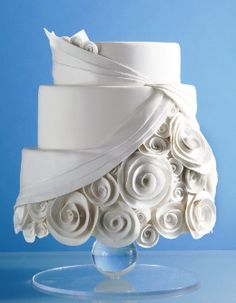 Stunning #White #WeddingCake Don't you just love the rosettes? It looks like it is showing the underskirt of a wedding dress. Most unusual