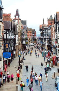 Foregate Street, in the city centre of Chester. Chester lies on the River Dee close to Wales, in the county of Cheshire. Look at that fantastic architecture!! and  the tiny little people are lovely as well. (Creative Commons License)