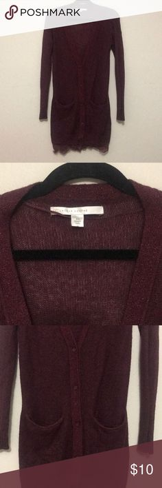 Long button down cardigan Maroon cardigan that buttons down from the center down. Real pockets. Sparkle trim around the neck, buttons, and pockets. Lace trim on bottom. Super soft, can be worn open or closed.  Lauren Conrad size XS, has a little stretch to it 67% Acrylic 31% Nylon 2% Other Fibers LC Lauren Conrad Sweaters Cardigans