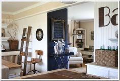 <3 ladders as shelves. ALSO love the hanging lamp in back corner.
