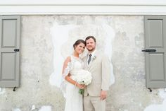 beautiful bride + groom w/ all white bridal bouquet by palmetto petals | the gadsden house | photo by priscilla thomas photography | king street hospitality group