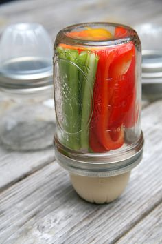 If you like eating two-ingredient snacks like veggies and hummus, here's a brilliant, inexpensive little hack to keep two ingredients separated. All you need is a wide-mouth pint or half-pint size mason jar and one of the plastic cups diced fruit comes in.