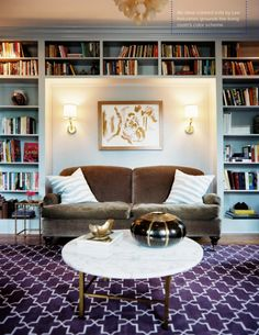 love the bookcases around the sofa instead of a fireplace!