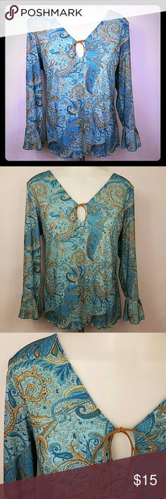 🆕 Boho top with leather tie and keyhole size XL Beautiful boho top that is several shades of blue tan and brown. In great condition. Ruffled hem and sleeves. Keyhole opening with leather tie. Only worn a few times. In great condition. St. John's Bay Tops Blouses