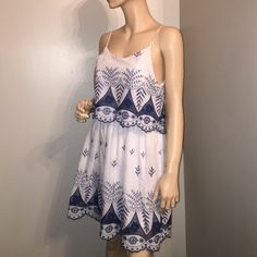 NWT Blue and white dress White dress with blue embroidered on it! New with tags, never worn. From boutique. We have a medium and large. Tinley Dresses Mini