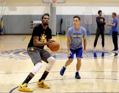 Golden State Warriors' Kevin Durant was back at practice on Fri. April 7, 2017, working with Steve Nash at the Warriors' practice facility in Oakland, Calif. Durant will be rejoining the team after recovering from a knee injury.
