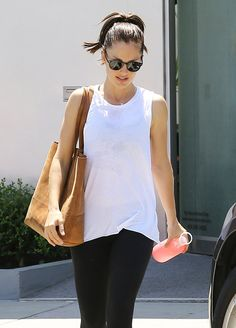 "As seen in InStyle's ""The Water Bottle Your Favorite Celebs Are Currently Obsessed with."" Celeb pictured: Minka Kelly. ""On her way to the gym, Kelly kept her gym attire simple and paired it with a chic, pink bkr bottle."""