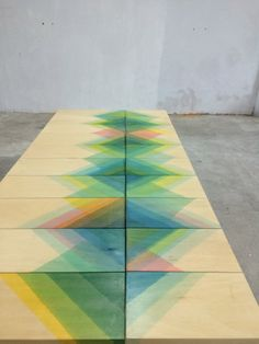 Herringbone collection by Raw Edges. The studio, led by designers Shay Alkalay and Yael Mer, created the Herringbone collection of tables, chairs and a screen by staining planks of untreated jelutong and pine wood in buckets of colourful dyes, each placed at a 45 degree angle.
