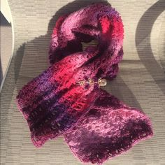 HANDMADE crocheted scarf w/pink butterfly clip. HANDMADE crocheted scarf with pink and gold colored butterfly clip. Beautiful variations of pink and purple. 50% wool 50% acrylic.   Accessories Scarves & Wraps