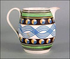 Mochaware - Mocha pitcher, 19th century with cat's eye and navy blue decorations, 6 3/4