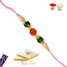 Buy #Rakhi #Gifts with #Green Round Pearl and #Natural Rudraksh from http://www.rakhistoreonline.com/rakhi/pearl-rakhi/green-round-pearl-with-natural-rudraksh.html