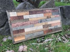 This brick style pattern wall art is the perfect piece to bring a little rustic style into a room. It is made with pine stained different colors to give it a rustic reclaimed wood look. The colors are quite exquisite together. No two pieces are the same, making this piece completely one of kind. I carefully choose the wood and thoughtfully choose which colors to stain them to give them the most enhancing look possible. This measures 25 12x12 1/2 and it comes with a preinstalled wire for...