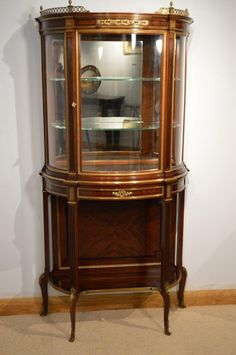 A stunning quality French mahogany & ormolu mounted bow front vitrine.
