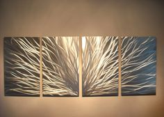 This piece is all silver. Any visible color is a reflection of objects in the room. This Abstract Metal Wall Art & Sculpture captures the interplay