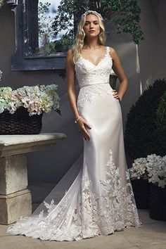 Showcase your gorgeous curves in a luxe, silky charmeuse sheath by Casablanca Bridal with lace-edged straps and an embellished skirt.