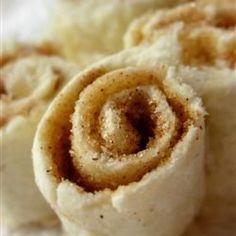 Slices of white bread are spread with butter and cinnamon sugar, then rolled and sliced into pinwheels, in an easy snack kids can make for themselves.